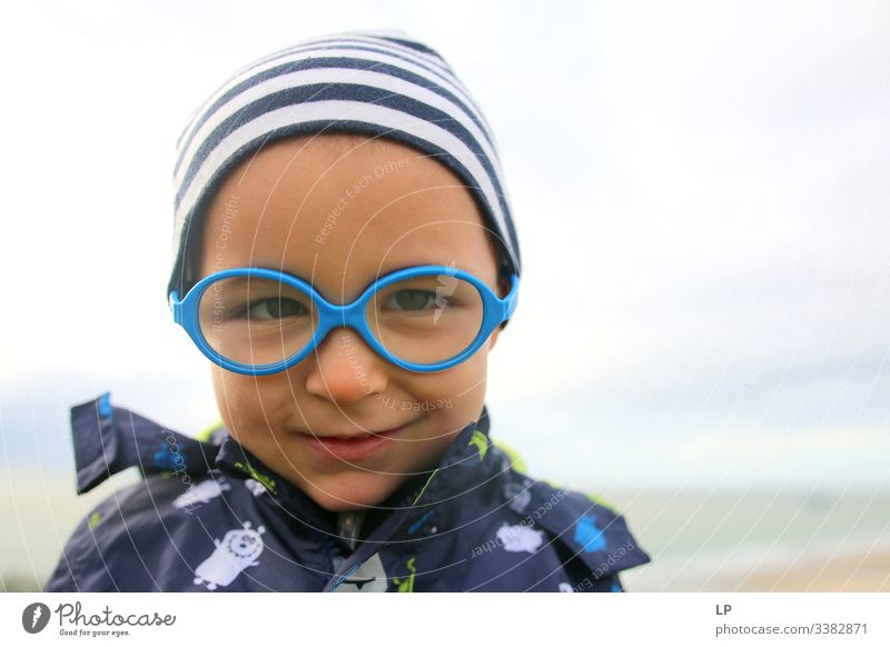 lovely child wearing glasses looking into the camera mindfulness Children's game Childhood memory Childhood wish Childhood dream inocence happiness,emotion