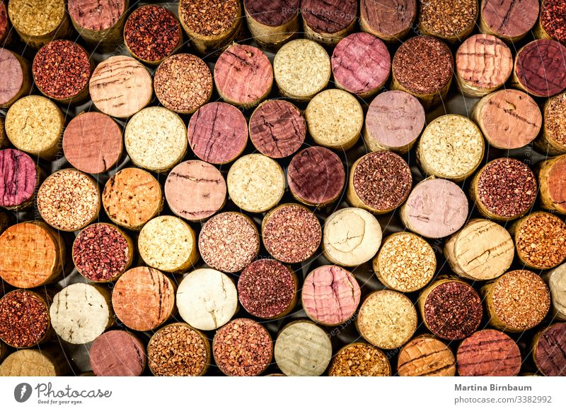 Full frame of wine corks stack vintage background closeup texture old alcohol winery red used full frame pattern wall circle purple wooden stopper many brown