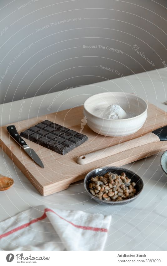 Table with Ingredients for pastry recipe ingredient cook food bake flour chocolate nut product prepare table utensil bowl kitchen home delicious cuisine