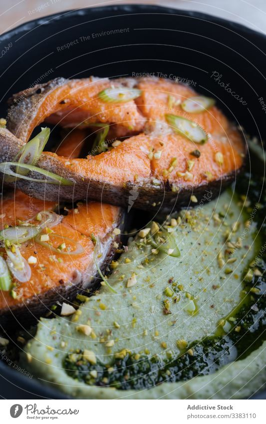 Tasty salmon steak with seasonings on plate spice recipe eat delicatessen pan fried fish food meal fresh cuisine dish gourmet seafood nutrition healthy dinner