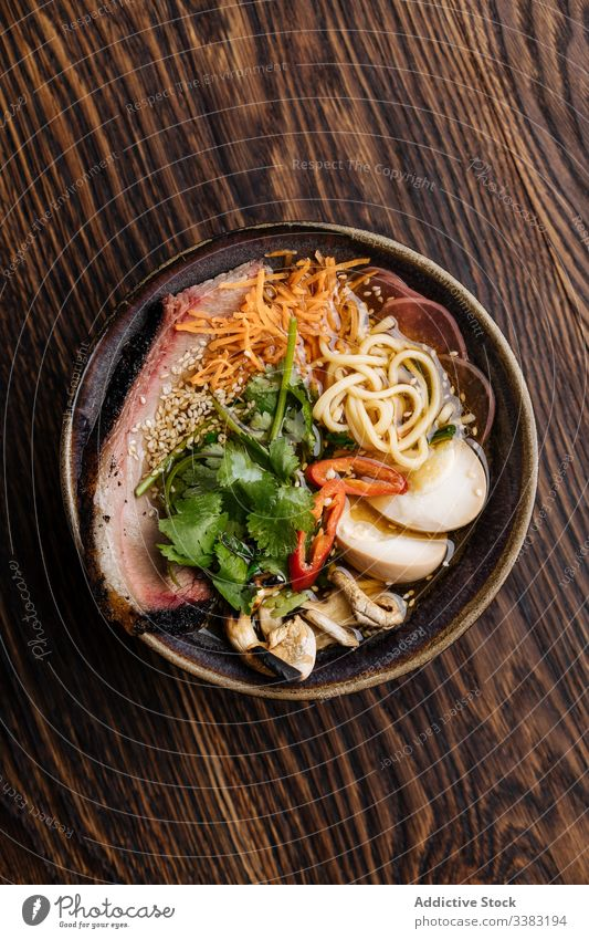 Tasty ramen soup with noodles on table vegetable serve bowl delicious food meal dish cuisine fresh gourmet lunch restaurant nutrition healthy portion ingredient