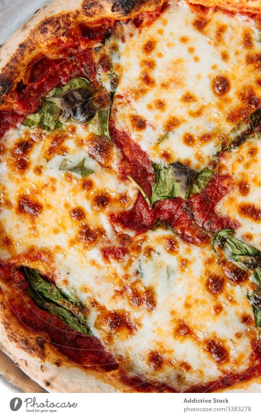 Fresh pizza with cheese in restaurant dish food meal tasty tradition italian lunch delicious cuisine round yummy fresh herb plate portion crust appetizing
