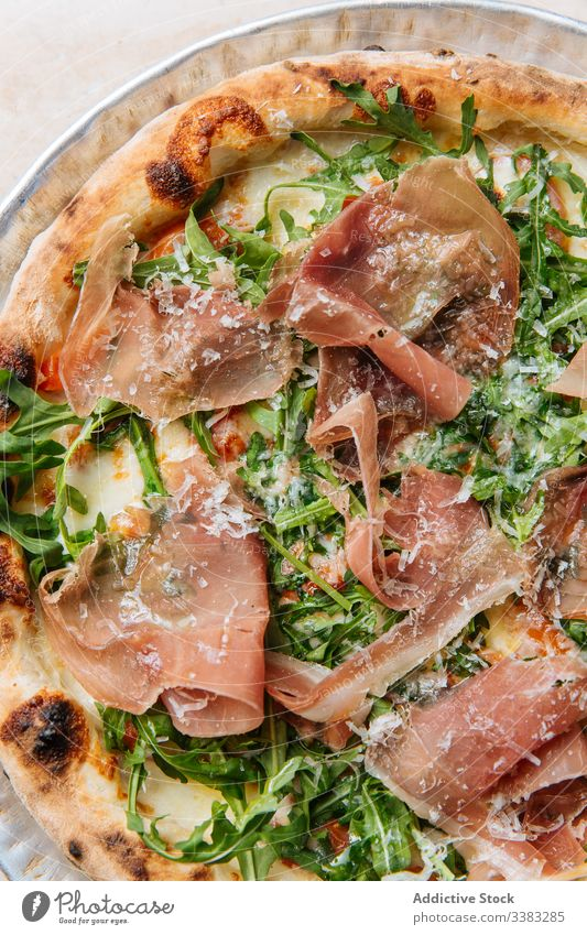 Delicious pizza with meat in restaurant bacon herb greenery dough baked italian food meal cuisine tasty lunch fresh table delicious tradition prepare dish snack