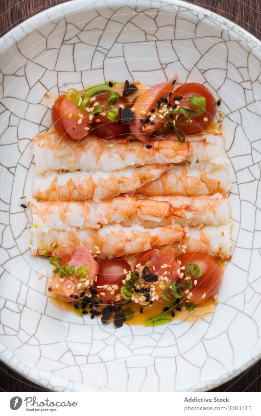 Appetizing seafood with tomatoes and herbs in ornamental plate shrimp sesame seed tasty fresh delicious gourmet dish cuisine condiment lunch portion yummy