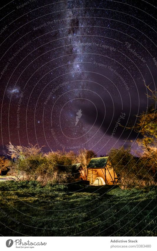 Camping at starry tranquil night sky camp glade milky way adventure idyllic trip tree nature clear travel environment tent light solitude freedom quiet cloud