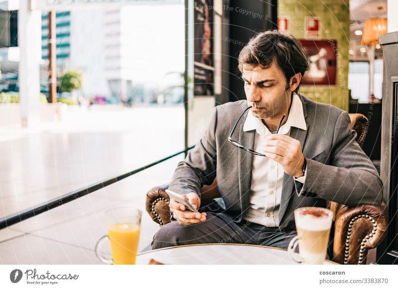 Worried businessman having a breakfast on a bar adult cafe cellphone city coffee computer copy space depressed depression discomfort executive exhausted fatigue