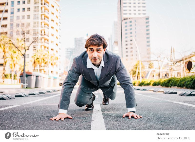 Businessman on a starter line with a city background asphalt barcelona begin beginner business businessman career challenge competition competitive competitor