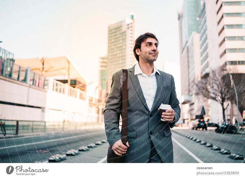 Happy businessman with a coffe on the city adult attractive barcelona blue broker caffeine casual caucasian ceo coffee corporate cup drink drinking employee