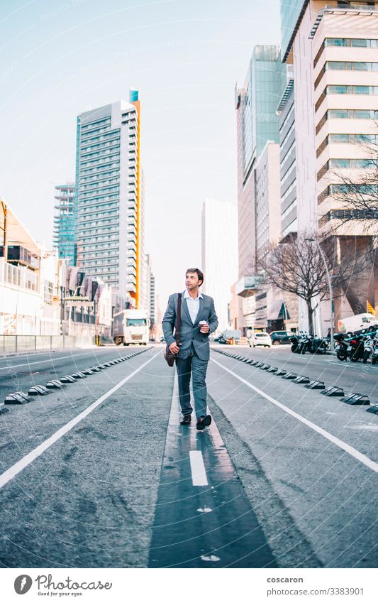 Middle aged businessman walking throw the city adult baggage bank barcelona building buildings company confidence confident corporate entrepreneur executive