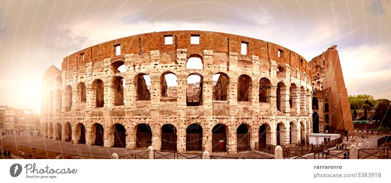 the Colosseum of Rome seen from behind at sunset. famous italian arena historical ruin colosseum rome amphitheater ancient ancient civilization ancient rome