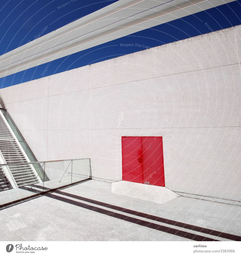 Red door on white wall with blue line under blue sky Wall (building) Facade Door Goal Line mark Blue Sky lines interstices Shadow Handrail Glass slats