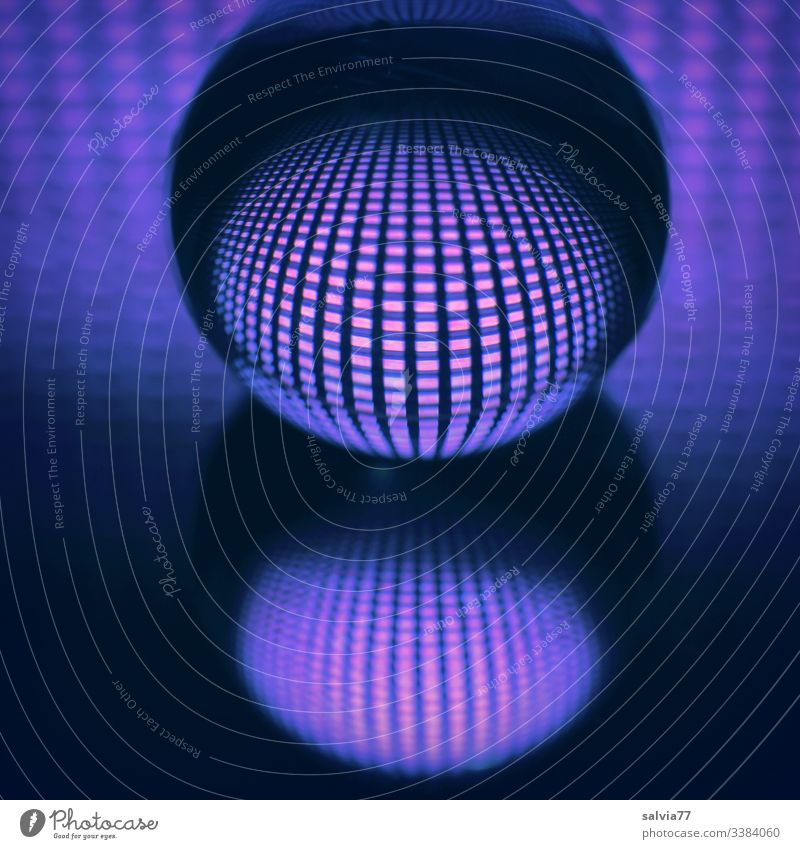 Symmetry | glass ball mirrored with grid pattern and blue light Glass ball Lighting effect Grating Pattern Abstract reflection Colour photo