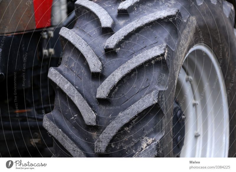 huge wheels of a new large tractor for agriculture heavy equipment vehicle tyre big power tire engine machinery modern industry black transportation farm