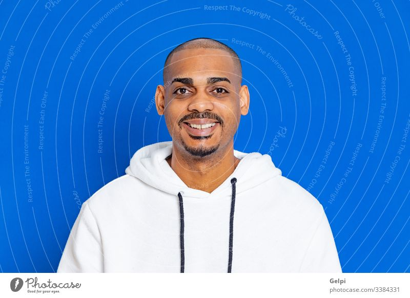 African guy wearing a white sweatshirt black blue cheerful relaxed self-confidence joyful looking at camera adult people person african male american man