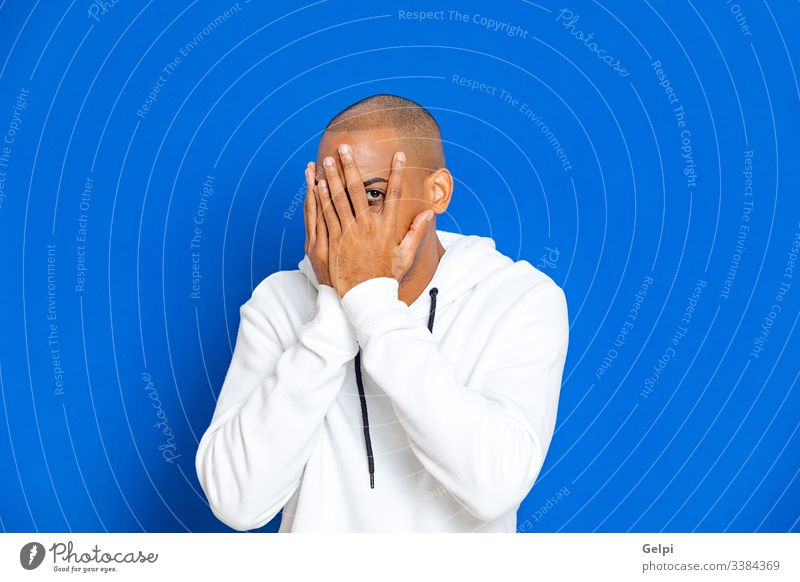 African guy wearing a white sweatshirt black blue sorry afraid fearful excited nervous adult people person african male american man isolated background studio