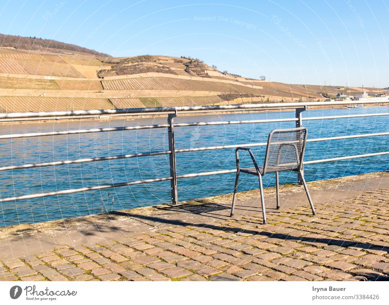 Lonely chair near with river in the sun day. bachground summer spring sunny outdoor sea swimming terrace view relax nature peace hotel beautiful sky water