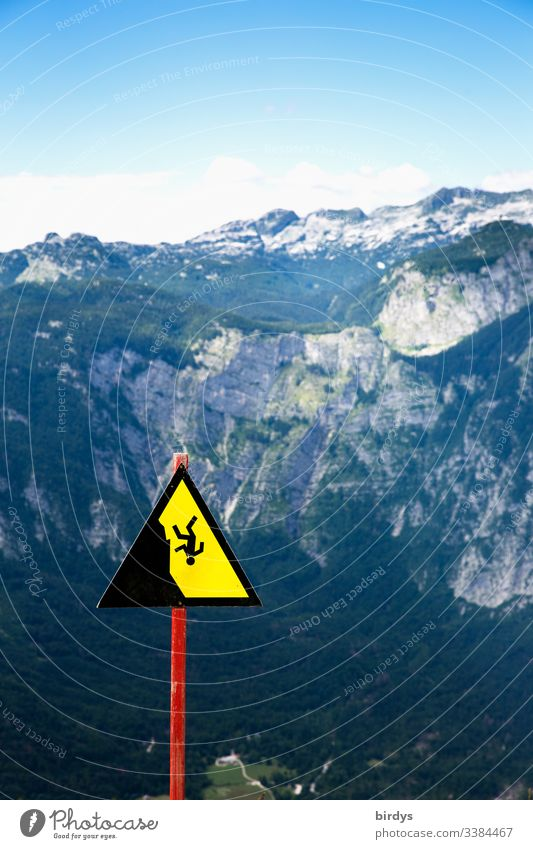 Dangerous terrain, warning sign in the Alps, warns of crash hazards Mountain Clouds Sky Nature Rock Peak Exterior shot Landscape Day Beautiful weather Deserted