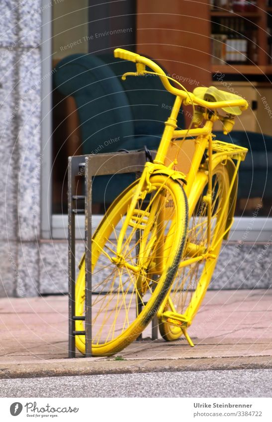 Yellow bicycle as decoration Bicycle turned off Decoration Attraction Eye-catcher Cycling Metal Means of transport Old Parking Town Bicycle rack Shop window