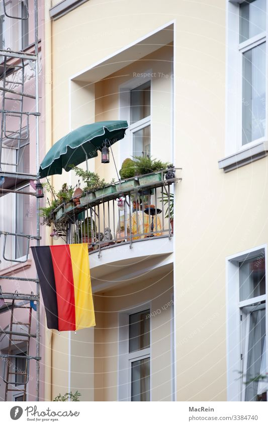 fly the flag Flag Balcony Germany Facade nobody Colour photo patriotic black Red Gold Sunshade Exterior shot German Flag Ensign Patriotism Day Pride