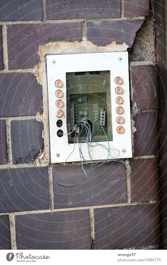 Neighbourhoods   what's left topic day neighbourhood bell shield bell button bell system broken Old loose wires Old building Deserted Colour photo