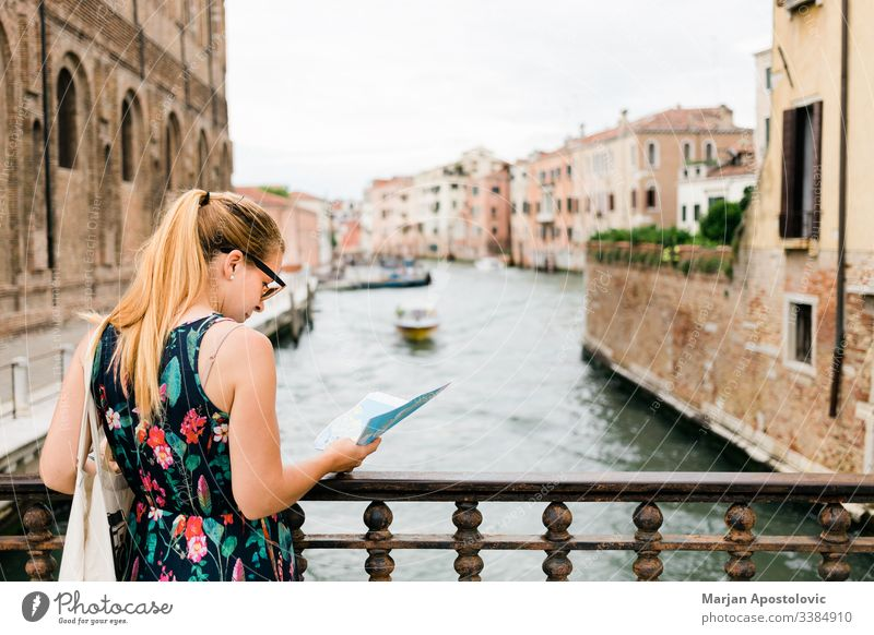 Young female traveler sightseeing in Venice , Italy adult architecture blogger boat bridge canal casual caucasian city cityscape cute europe european famous