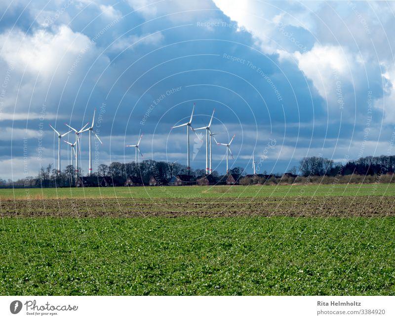 Wind turbines near houses and fields windmills wind farm repowering Colour photo Landscape Renewable energy Weather Clouds Raincloud Exterior shot Nature