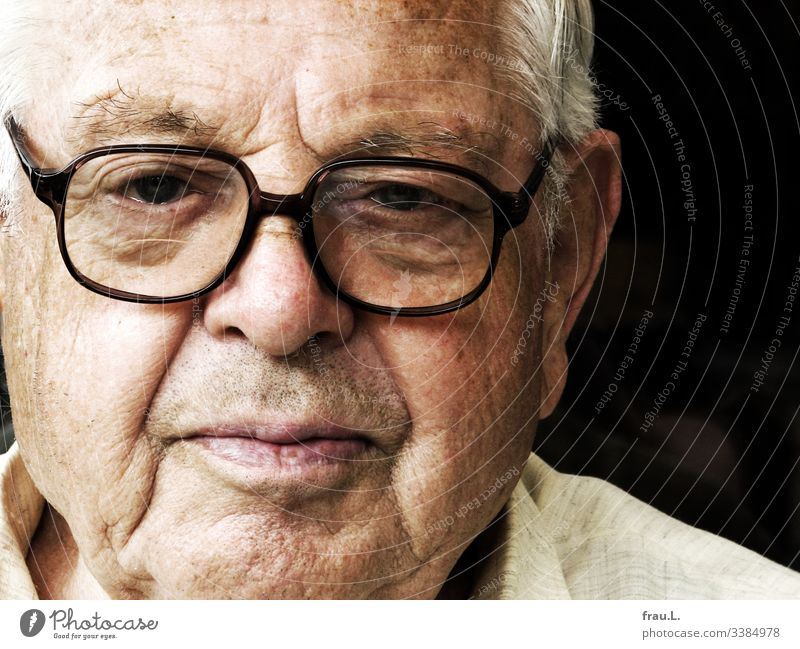 The new glasses on his old nose made him look critically. Man Human being Face Portrait photograph Eyeglasses Senior citizen Male senior critical view Skeptical