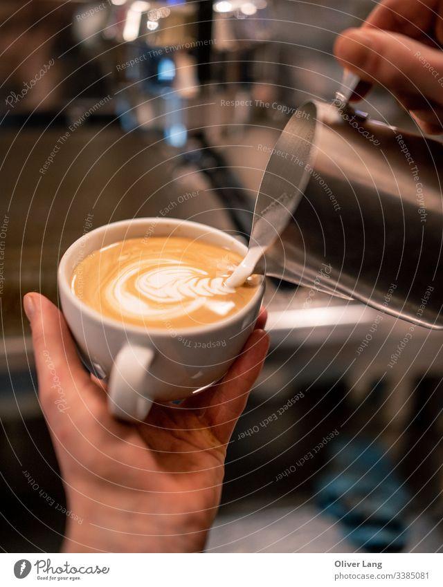 Milk Pouring Latte Art into Espresso barista espresso hot drink latte art coffee making Café Café au lait double espresso cup espresso based coffee cup