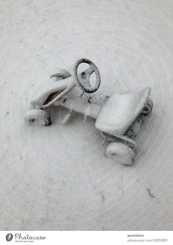 Snowy pedal car Infancy snowy White Winter chill snowed in Deserted Day Colour photo Exterior shot Nature Weather Mobility