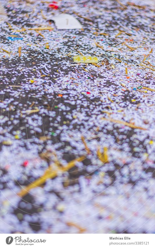 Colorful confetti on the street Colour photo Confetti Happiness Street Exterior shot Multicoloured Lie Structures and shapes Bird's-eye view Sidewalk Light