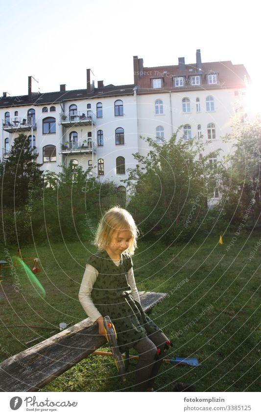 Kid with water gun in a backyard garden Child Girl be a child Childlike children preschool child Parenting Infancy children's toy childcare Toddler look Wait
