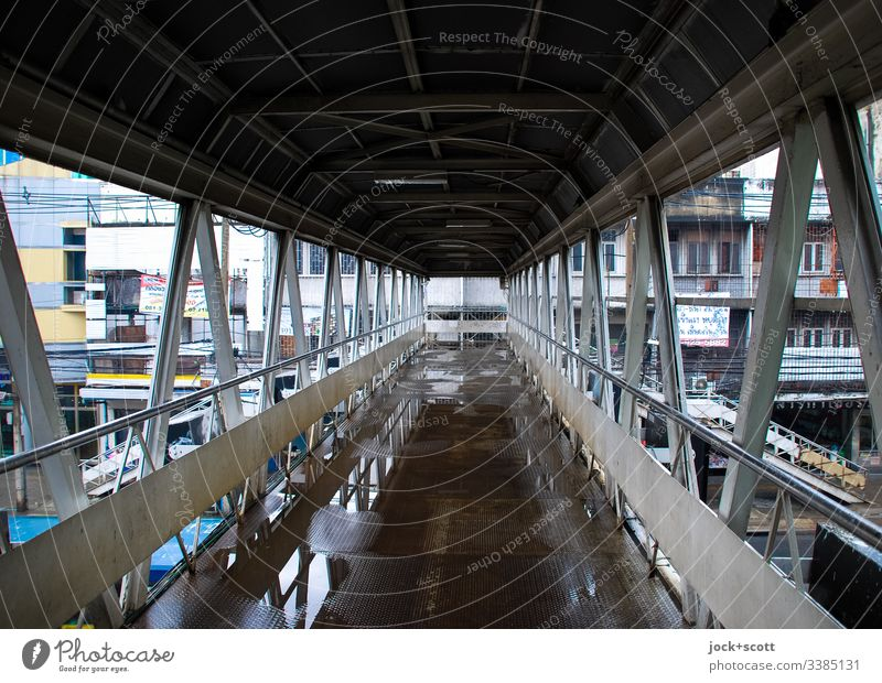 Pedestrian bridge in Bangkok color picture rainy day Background picture Reflection Structures and shapes Central perspective Day Exterior shot Colour photo