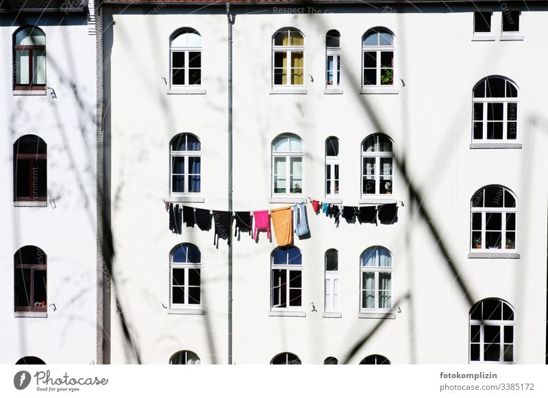 Clothesline on house front Laundry house facade Washing Old building Apartment house Washing day Clothing Household Dry Hang up hanging up laundry Window