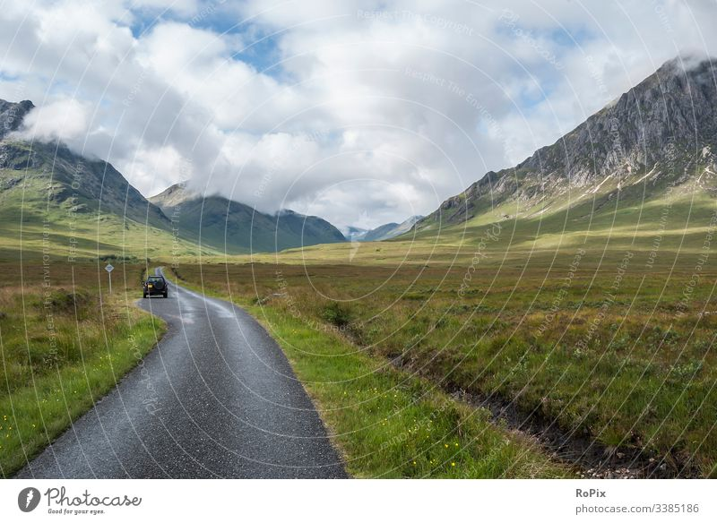 Single track road in the scottish highlands. Scotland lake Glencoe Scottish Britain England freedom meadow landscape sky natural mountain nature travel glenn