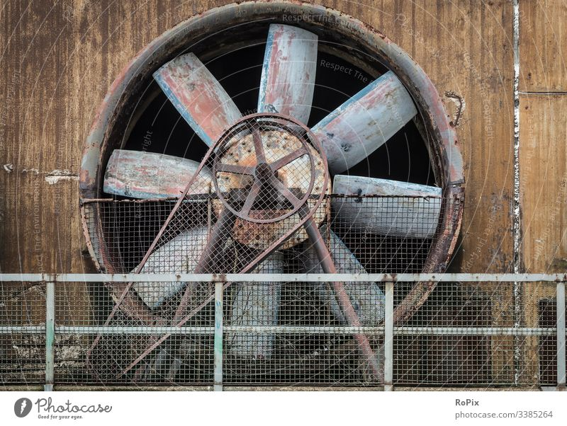 Industrial cooling fan on a deserted facility. compressor wheel old concrete blower supercharger production industry iron steel steelworks lost place metal