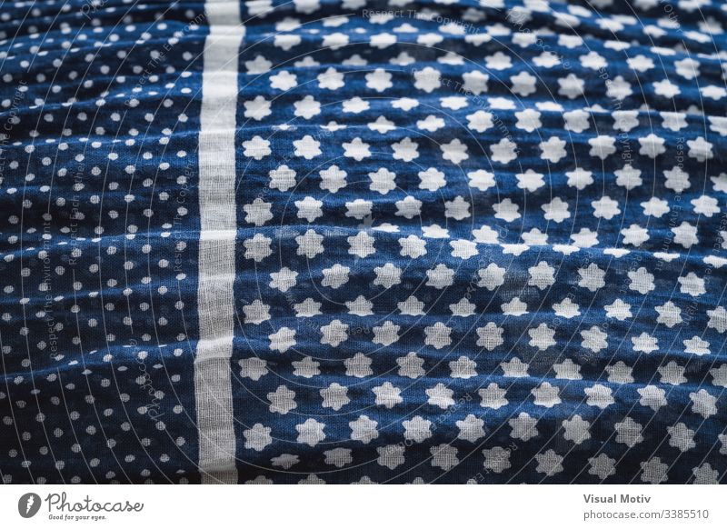 Detail of a crumpled shawl in blue fabric texture textured fashion background surface design abstract closeup nobody detail clothing material textile relief