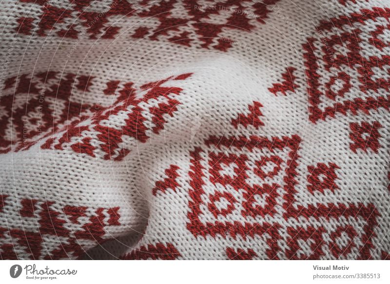 Detail of scandinavian red motifs industry textured cardigan fashion background surface design abstract closeup nobody detail knitwear knit up clothing material
