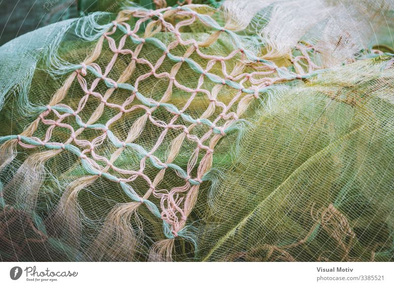 Macrame knots decorating a crumpled shawl fabric texture textured fashion background surface design abstract closeup nobody detail clothing material textile
