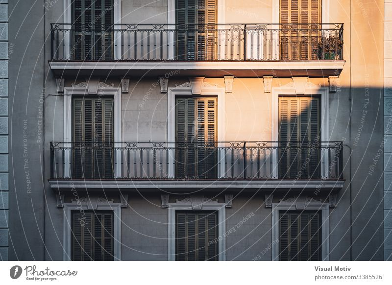 Sunset lights illuminating some balconies of a building color architecture architectural architectonic outdoor outdoors exterior urban city natural light