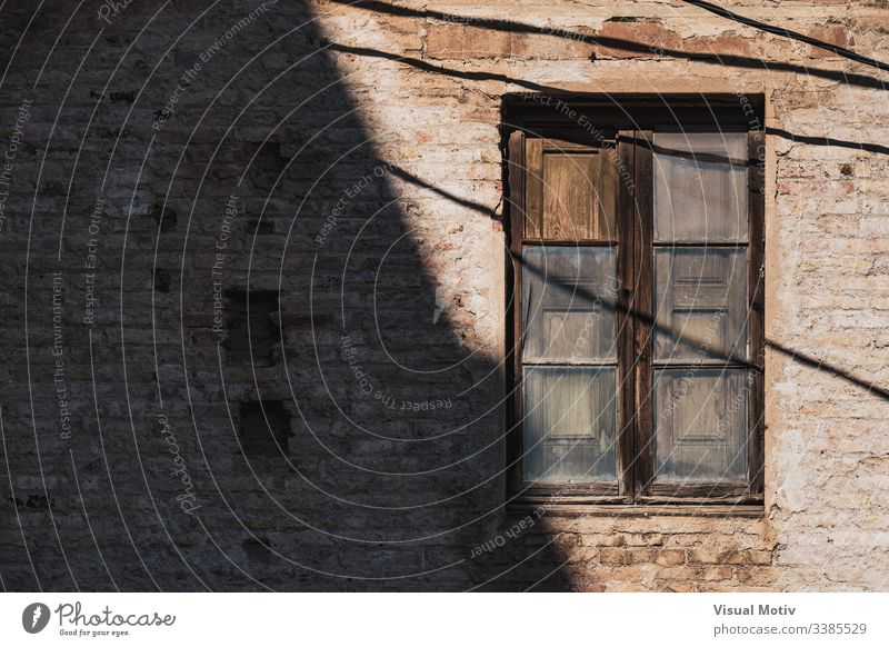 Wooden window of an old red brick building color traditional architecture architectural architectonic abstract outdoor outdoors exterior facade wooden