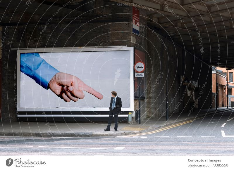 Billboard pointing at businessman it could be you billboard finger humour admire adult architecture building caucasian city city life color commuter