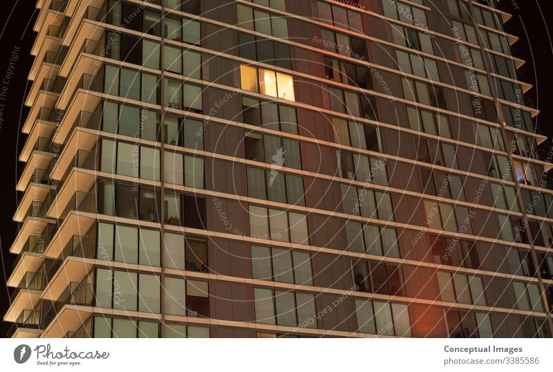 Single lit window in a modern apartment abstract architecture background bright city living color concepts concepts and topics contemporary creativity design