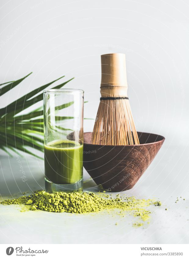 Matcha tea powder with glass of matcha espresso and matcha whisk set. Healthy lifestyle concept matcha tea healthy antioxidant japan aromatic zen herbal