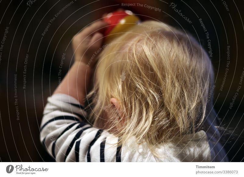 1900. Having fun and trying new things Toddler Hair and hairstyles Blonde girl Infancy Juggle juggling balls Head Playing Curiosity Joy