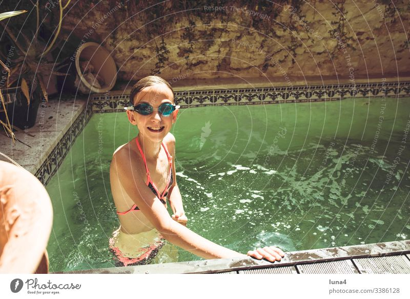 Girls in the swimming pool bathe Eyeglasses Swimming goggles splashing fortunate Water teenager youthful Laughter Hot Joy To enjoy Refreshment pleasure holidays