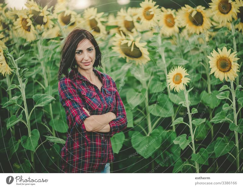 Young Woman in Sunflower Field enjoy environment beautiful farm field freedom fun girl hair happy woman healthy landscape laugh life lifestyle meadow natural