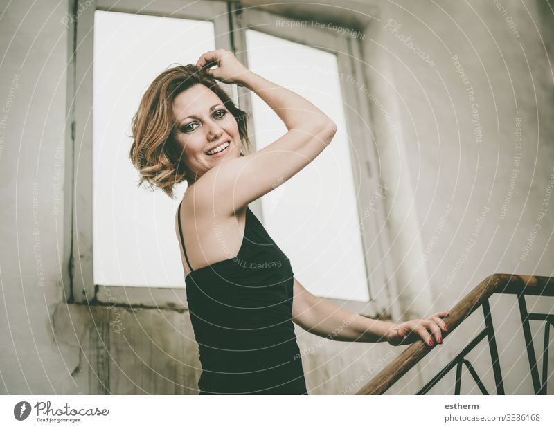 Happy and smiling Beautiful young woman pretty fashion elegant happy happiness beautiful portrait pose caucasian smile laugh joy confidence fun party