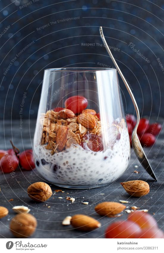 Chia pudding parfait with red grapes and almonds jar chia nuts seed chia seeds dairy dessert diet fruit glass breakfast greek yogurt healthy eating homemade