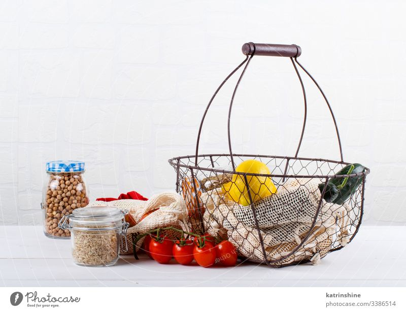 Fresh vegetables, fuits  and grains in textile bags and glass jars Zero waste basket concept farmers close up zero food shopping reusable healthy natural