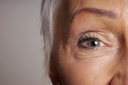 close-up of senior woman with green eyes mature eyesight vision face aging see adult old lady older female elderly age contacts contact lens women human macro